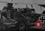 Image of Loading bombs in cockpit of German airplane France, 1917, second 10 stock footage video 65675055374