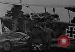 Image of Loading bombs in cockpit of German airplane France, 1917, second 11 stock footage video 65675055374