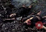 Image of dead Viet Cong Vietnam Vinh Te Canal, 1969, second 2 stock footage video 65675055543