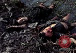 Image of dead Viet Cong Vietnam Vinh Te Canal, 1969, second 7 stock footage video 65675055543