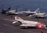 Image of U.S. Navy aircraft on flight deck of an aircraft carrier South China Sea, 1966, second 2 stock footage video 65675055557