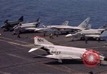 Image of U.S. Navy aircraft on flight deck of an aircraft carrier South China Sea, 1966, second 3 stock footage video 65675055557