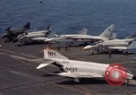 Image of U.S. Navy aircraft on flight deck of an aircraft carrier South China Sea, 1966, second 6 stock footage video 65675055557