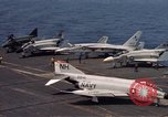 Image of U.S. Navy aircraft on flight deck of an aircraft carrier South China Sea, 1966, second 7 stock footage video 65675055557