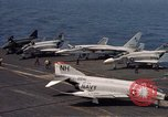 Image of U.S. Navy aircraft on flight deck of an aircraft carrier South China Sea, 1966, second 9 stock footage video 65675055557