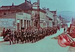 Image of German troops marching to surrender to Western Allies Pilsen Czechoslovakia, 1945, second 4 stock footage video 65675055608