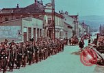 Image of German troops marching to surrender to Western Allies Pilsen Czechoslovakia, 1945, second 20 stock footage video 65675055608