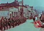 Image of German troops marching to surrender to Western Allies Pilsen Czechoslovakia, 1945, second 21 stock footage video 65675055608