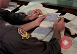 Image of checking of flip charts Philippines, 1979, second 6 stock footage video 65675055620