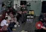 Image of load master on aircraft Philippines, 1979, second 2 stock footage video 65675055626