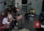 Image of load master on aircraft Philippines, 1979, second 5 stock footage video 65675055626