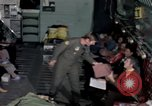 Image of load master on aircraft Philippines, 1979, second 7 stock footage video 65675055626