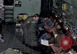 Image of load master on aircraft Philippines, 1979, second 11 stock footage video 65675055626