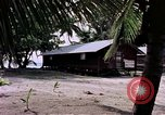 Image of buildings at beach Diego Garcia Island Indian Ocean, 1979, second 2 stock footage video 65675055647