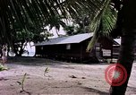 Image of buildings at beach Diego Garcia Island Indian Ocean, 1979, second 3 stock footage video 65675055647