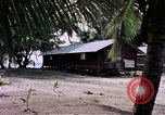 Image of buildings at beach Diego Garcia Island Indian Ocean, 1979, second 9 stock footage video 65675055647