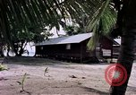 Image of buildings at beach Diego Garcia Island Indian Ocean, 1979, second 10 stock footage video 65675055647