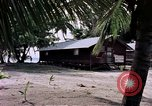 Image of buildings at beach Diego Garcia Island Indian Ocean, 1979, second 11 stock footage video 65675055647
