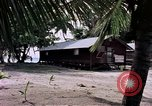 Image of buildings at beach Diego Garcia Island Indian Ocean, 1979, second 12 stock footage video 65675055647