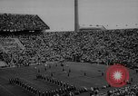 Image of football match East Lansing Michigan USA, 1958, second 7 stock footage video 65675055663