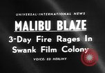 Image of raging forest fire Malibu California USA, 1958, second 4 stock footage video 65675055665