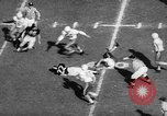 Image of American football match New York United States USA, 1958, second 11 stock footage video 65675055672