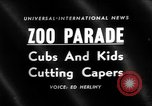 Image of children at zoo Canada, 1959, second 2 stock footage video 65675055776