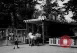 Image of children at zoo Canada, 1959, second 8 stock footage video 65675055776