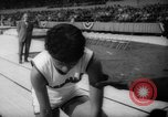 Image of indoor track and field meet California United States USA, 1962, second 10 stock footage video 65675055885