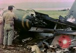 Image of wrecked American Vought FG-1D Corsair airplane Nagasaki Japan, 1945, second 12 stock footage video 65675055939