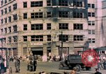 Image of U.S. sailors in Japanese city downtown Nagasaki Japan, 1945, second 9 stock footage video 65675055940
