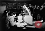 Image of voters lined up Egypt, 1953, second 9 stock footage video 65675056002