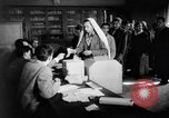 Image of voters lined up Egypt, 1953, second 10 stock footage video 65675056002