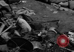 Image of people search through dump Germany, 1946, second 4 stock footage video 65675056082