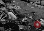 Image of people search through dump Germany, 1946, second 9 stock footage video 65675056082