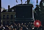 Image of civilians in street square Luxembourg, 1945, second 11 stock footage video 65675056170