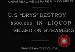 Image of Canadian rum cargo destroyed in prohibition San Francisco California USA, 1930, second 6 stock footage video 65675056183