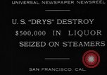Image of Canadian rum cargo destroyed in prohibition San Francisco California USA, 1930, second 7 stock footage video 65675056183