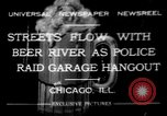 Image of police raid at garage Chicago Illinois USA, 1932, second 1 stock footage video 65675056184
