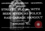 Image of police raid at garage Chicago Illinois USA, 1932, second 3 stock footage video 65675056184