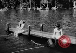 Image of water ski show Florida United States USA, 1957, second 4 stock footage video 65675056228