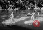 Image of water ski show Florida United States USA, 1957, second 7 stock footage video 65675056228