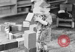 Image of children at nursery school United States USA, 1935, second 2 stock footage video 65675056245