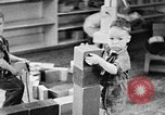 Image of children at nursery school United States USA, 1935, second 10 stock footage video 65675056245