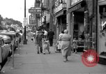Image of Streets and shops of town Ottumwa Iowa USA, 1958, second 2 stock footage video 65675056276