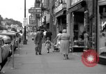 Image of Streets and shops of town Ottumwa Iowa USA, 1958, second 3 stock footage video 65675056276