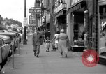 Image of Streets and shops of town Ottumwa Iowa USA, 1958, second 4 stock footage video 65675056276