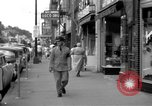 Image of Streets and shops of town Ottumwa Iowa USA, 1958, second 7 stock footage video 65675056276