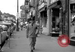 Image of Streets and shops of town Ottumwa Iowa USA, 1958, second 8 stock footage video 65675056276