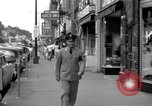 Image of Streets and shops of town Ottumwa Iowa USA, 1958, second 9 stock footage video 65675056276